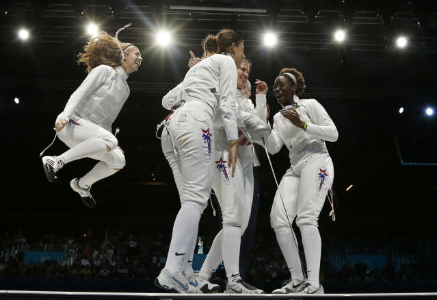 (L-R) Susie Scanlan Kelley Hurley, Courtney Hurley and Maya Lawrence of the U.S. celebrate their victory at the end of the women's eppe team bronze medal fencing competition against Russia at the ExCel venue during the London 2012 Olympic Games August 4, 2012. REUTERS/Damir Sagolj (BRITAIN - Tags: OLYMPICS SPORT FENCING TPX IMAGES OF THE DAY)