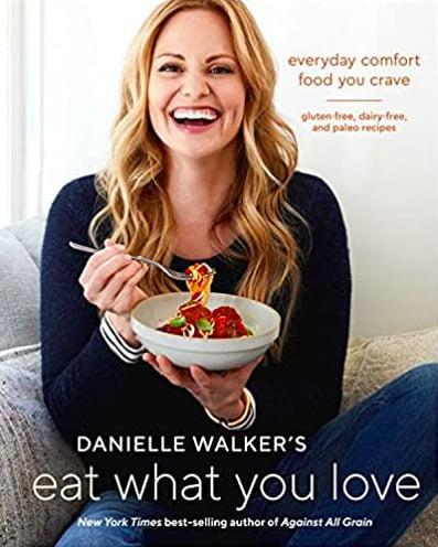 """<p>Food blogger and <strong>New York Times</strong> bestselling author Danielle Walker is offering up 125 comforting weeknight meals in the cookbook <span><strong>Danielle Walker's Eat What You Love: Everyday Comfort Food You Crave; Gluten-Free, Dairy-Free, and Paleo Recipes</strong></span> ($24). The mother of three aims to make your life easier with four weeks of meal plans, make-ahead meals (including freezer and leftover options!), sheet-pan suppers, and one-pot dishes. With over 1,000 ratings and five stars on Amazon, it's clear Walker's comfort-food classics like fried chicken, sloppy Joes, shrimp and grits, chicken pot pie, and lasagna deliver flavor that doesn't disappoint.</p> <p>Click <a href=""""https://www.popsugar.com/smart-living/Health-Wellness-Tips-46521311"""" class=""""link rapid-noclick-resp"""" rel=""""nofollow noopener"""" target=""""_blank"""" data-ylk=""""slk:here for more health and wellness stories, tips, and news"""">here for more health and wellness stories, tips, and news</a></p>"""