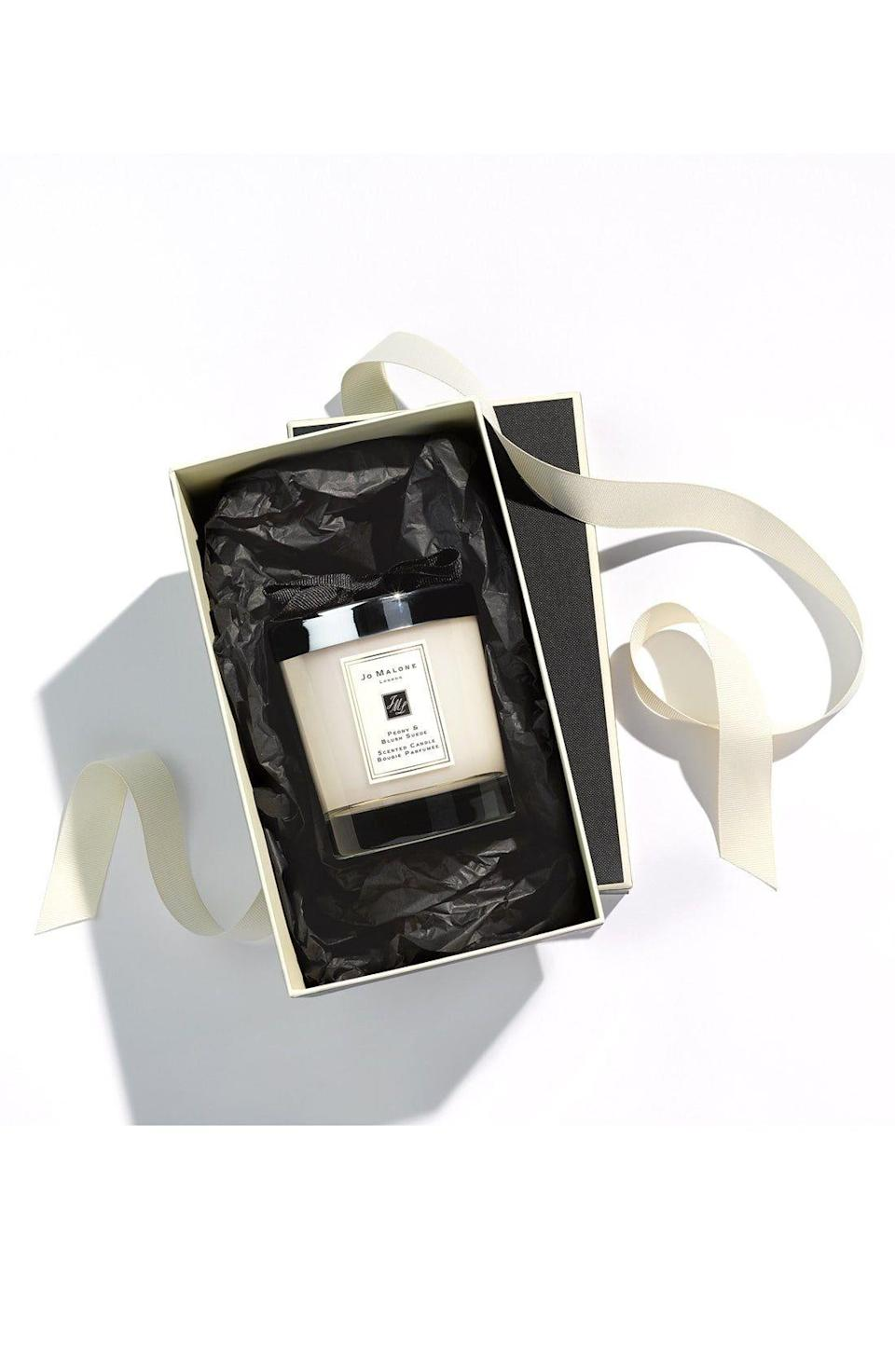 """<p><strong>JO MALONE LONDON\u003CSUP\u003E\u003C\u002FSUP\u003E</strong></p><p>nordstrom.com</p><p><strong>$69.00</strong></p><p><a href=""""https://go.redirectingat.com?id=74968X1596630&url=https%3A%2F%2Fwww.nordstrom.com%2Fs%2Fjo-malone-london-peony-blush-suede-scented-candle%2F3584269&sref=https%3A%2F%2Fwww.womansday.com%2Frelationships%2Fg3242%2Fgifts-for-couples%2F"""" rel=""""nofollow noopener"""" target=""""_blank"""" data-ylk=""""slk:Shop Now"""" class=""""link rapid-noclick-resp"""">Shop Now</a></p><p>If you're gifting for a couple you don't know that well or are looking for something more generic, a Jo Malone candle is a luxurious treat. The brand is well-known for their gorgeous, long-lasting scents that have kept customers coming back for years.</p>"""