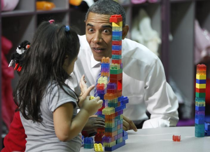 Yes, blocks are pretty cool: President Obama reacts—uh, maybe overreacts—as a child plays with building blocks during his visit to a classroom at Yeadon Regional Head Start Center in Yeadon, Pa., back in 2011. (Charles Dharapak/AP Photo)
