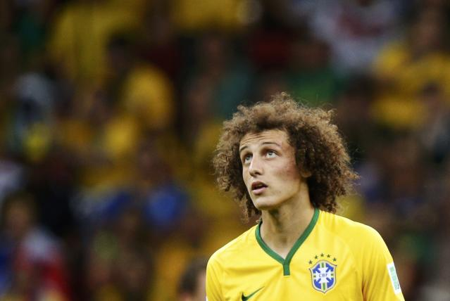 Brazil's David Luiz looks on during their 2014 World Cup third-place playoff against the Netherlands at the Brasilia national stadium in Brasilia July 12, 2014. REUTERS/Ueslei Marcelino (BRAZIL - Tags: SOCCER SPORT WORLD CUP)