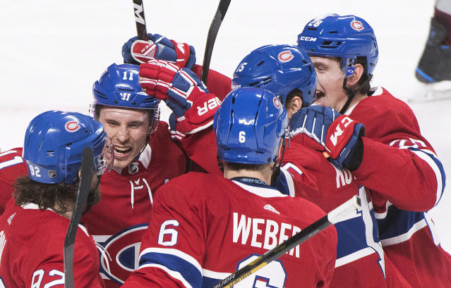 Montreal Canadiens' Jesperi Kotkaniemi (15), celebrates with teammates Jonathan Drouin (92), Brendan Gallagher (11), Shea Weber (6) and Mike Reilly, right, after scoring against the Colorado Avalanche during the third period of an NHL hockey game Saturday, Jan. 12, 2019, in Montreal. (Graham Hughes/The Canadian Press via AP)
