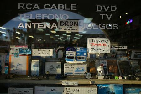 Electronic items are displayed in a shop window in Calexico, California, United States, October 7, 2016. REUTERS/Mike Blake