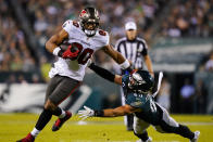 Tampa Bay Buccaneers tight end O.J. Howard (80) runs with the ball past Philadelphia Eagles outside linebacker Alex Singleton (49) during the first half of an NFL football game Thursday, Oct. 14, 2021, in Philadelphia. (AP Photo/Matt Rourke)