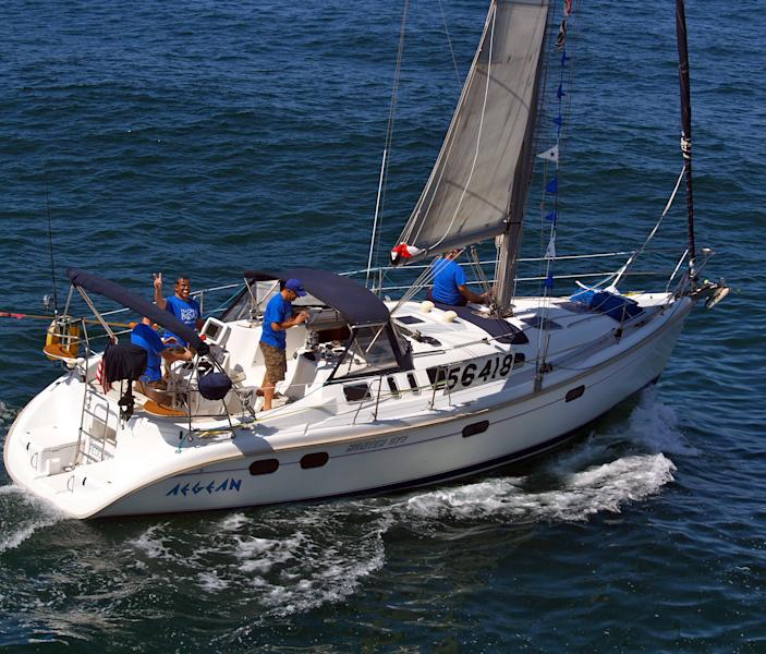 This Friday, April 27, 2012, photo shows the Aegean with crew members at the start of a 125-mile Newport Beach, Calif. to Ensenada, Mexico yacht race. The 37-foot Aegean, carrying a crew of four, was reported missing Saturday, the U.S. Coast Guard said. The yacht appeared to have collided at night with a much larger vessel, leaving three crew members dead and one missing, The Newport Ocean Sailing Association said Sunday, April 29. Race officials believe there are few other possibilities for what caused the accident. (AP Photo/newportbeach.patch.com, Susan Hoffman) MANDATORY CREDIT; LINK TO STORY: http://patch.com/A-sPbD