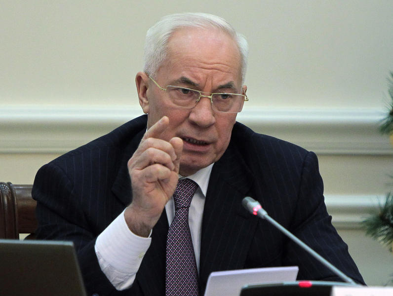"""FILE - In this Wednesday, Dec. 18, 2013 file photo, Ukrainian Prime Minister Mykola Azarov gestures while speaking at a cabinet meeting in Kiev, Ukraine. The prime minister of crisis-torn Ukraine has submitted his resignation. In a statement Tuesday, Jan. 28, 2014 on the government website, Mykola Azarov offered his resignation in order to encourage what he called """"social-political compromise."""" (AP Photo/Sergei Chuzavkov)"""