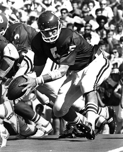 This undated photo provided by OU Athletics Communications shows quarterback Steve Davis during a football game. A University of Oklahoma official says the starting quarterback for Oklahoma's national championship teams in 1974 and 1975 is one of two men killed when a small plane slammed into a house in northern Indiana on Sunday, March 17, 2013. St. Joseph County Coroner Randy Magdalinski identified the victims of Sunday's crash as 60-year-old Steven Davis and 58-year-old Wesley Caves, both of Tulsa, Okla. (AP Photo/OU Athletics Communications)