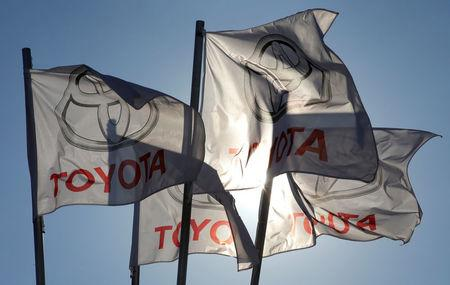 FILE PHOTO - Toyota flags wave at Motorcity Toyota dealership in Rome, Italy  October 10, 2012.  REUTERS/Max Rossi/File Photo