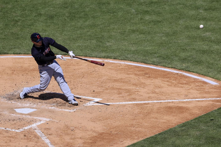 Cleveland Indians' Roberto Perez hits a three-run home run during the fourth inning of a baseball game against the Cincinnati Reds in Cincinnati, Sunday, April 18, 2021. (AP Photo/Aaron Doster)