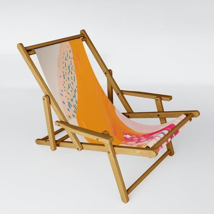 """<h3><h2>Society6 The Abstract Shape Of Spring Sling Chair</h2></h3><br>Beyond supporting your caboose, this hammock-style sling chair covered in a beautiful kinetic print <a href=""""https://society6.com/morganharpernichols"""" rel=""""nofollow noopener"""" target=""""_blank"""" data-ylk=""""slk:designed by artist Morgan Harper Nichols"""" class=""""link rapid-noclick-resp"""">designed by artist Morgan Harper Nichols</a> also supports Black creatives. The chair itself is crafted with multi-position recliner capabilities, is UV- and water-resistant, and collapsible. <br><br>Check out <a href=""""https://society6.com/collection/discover-black-artists"""" rel=""""nofollow noopener"""" target=""""_blank"""" data-ylk=""""slk:Society6's Discover Black Artists"""" class=""""link rapid-noclick-resp"""">Society6's Discover Black Artists</a>' collection page for more beautiful work.<br><br><strong>Society6</strong> The Abstract Shape Of Spring Sling Chair, $, available at <a href=""""https://go.skimresources.com/?id=30283X879131&url=https%3A%2F%2Fsociety6.com%2Fproduct%2Fthe-abstract-shape-of-spring_sling-chair"""" rel=""""nofollow noopener"""" target=""""_blank"""" data-ylk=""""slk:Morgan Harper Nichols"""" class=""""link rapid-noclick-resp"""">Morgan Harper Nichols</a>"""