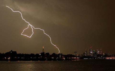 Lightning strikes over London - Credit: EUTERS/Tom Jacobs