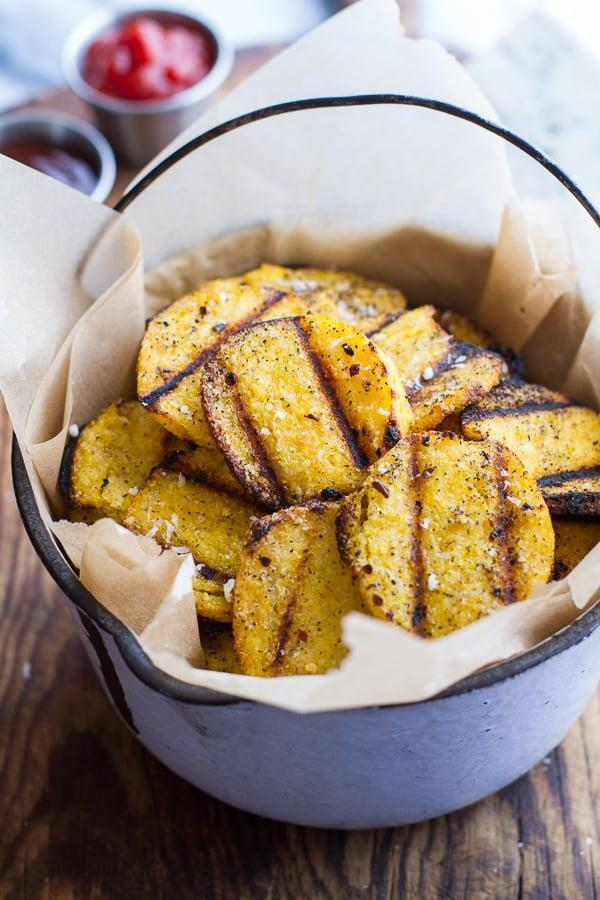 "<p>Offer a new type of ""chip"" at the dinner table with these ones made of polenta.</p> <p> <strong>Get the recipe</strong>: <a href=""http://www.halfbakedharvest.com/easy-grilled-parmesan-polenta-chips"" class=""link rapid-noclick-resp"" rel=""nofollow noopener"" target=""_blank"" data-ylk=""slk:grilled parmesan polenta chips"">grilled parmesan polenta chips</a> </p>"