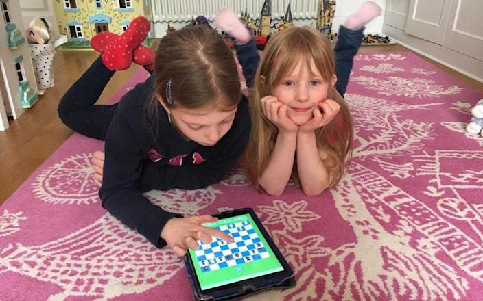 Clementine (7) and Florence (9) play chess