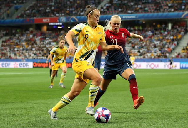 Caitlin Foord of Australia runs with the ball under pressure from Karina Saevik of Norway during the 2019 FIFA Women's World Cup France Round Of 16 match between Norway and Australia at Stade de Nice on June 22, 2019 in Nice, France. (Photo by Hannah Peters - FIFA/FIFA via Getty Images)