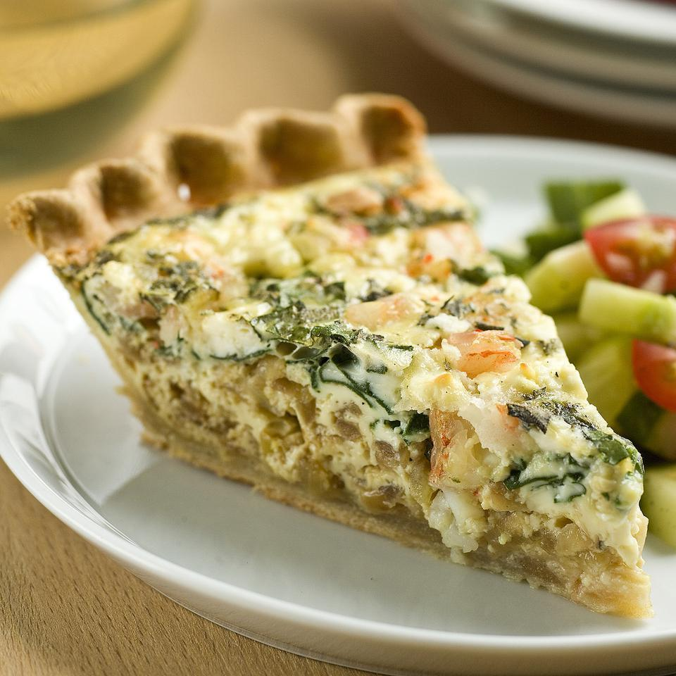 <p>This healthy quiche recipe is perfect for entertaining--the quiche can be made ahead and is just as flavorful served warm or at room temperature. Filled with shrimp, spinach, oregano, caramelized onions and feta cheese, this healthy quiche with a whole-grain crust is perfect for breakfast or brunch, or served with a light salad for lunch.</p>