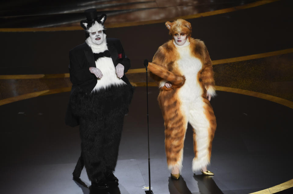 James Corden, left, and Rebel Wilson present the award for best visual effects at the Oscars on Sunday, Feb. 9, 2020, at the Dolby Theatre in Los Angeles. (AP Photo/Chris Pizzello)