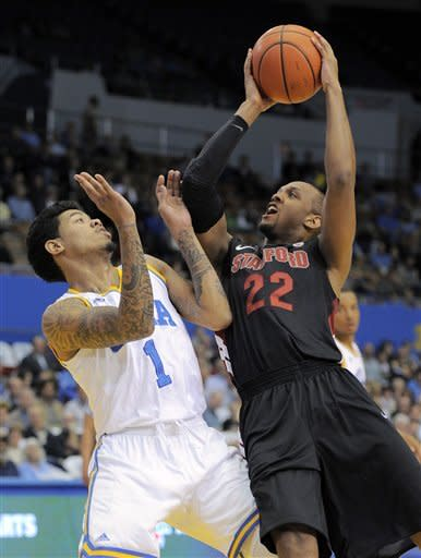 Stanford guard Jarrett Mann, right, puts up a shot as UCLA guard Tyler Lamb defends during the first half of an NCAA college basketball game, Thursday, Feb. 9, 2012, in Los Angeles. (AP Photo/Mark J. Terrill)