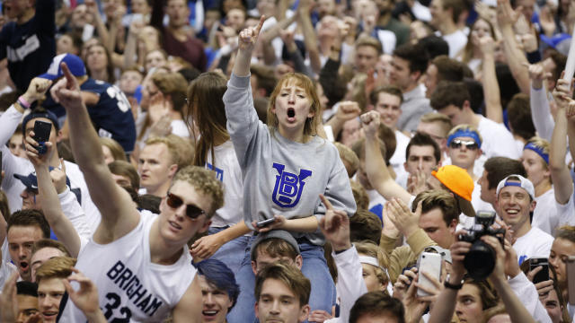 BYU students and fans celebrate on the court following BYU's 91-78 victory over Gonzaga in an NCAA college basketball game Saturday, Feb. 22, 2020, in Provo, Utah. (AP Photo/Rick Bowmer)