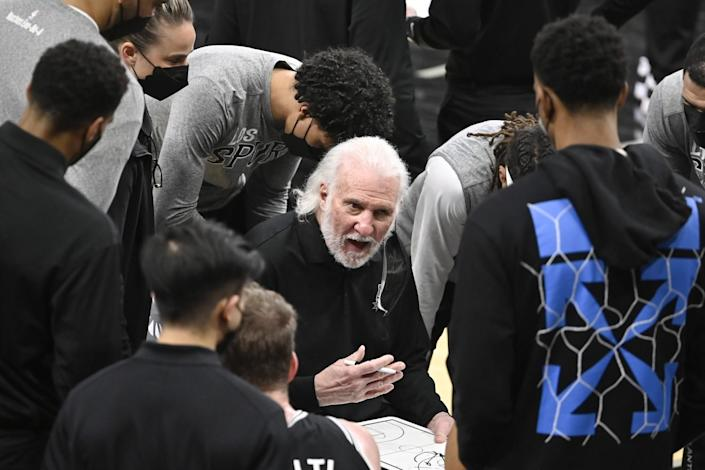 San Antonio Spurs head coach Gregg Popovich talks to his players during a game against the Charlotte Hornets on March 22.