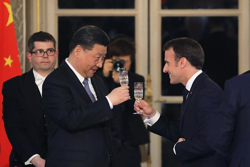 French President Emmanuel Macron hosted a state dinner Monday for Chinese President Xi Jinping with some 200 guests (AFP Photo/LUDOVIC MARIN)