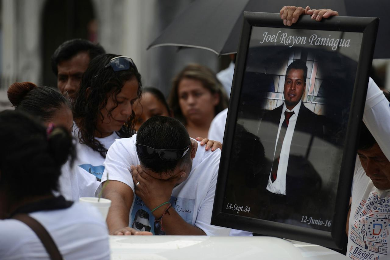 <p>Relatives of Joel Rayon Paniagua, one of the victims of the shooting at the Pulse night club in Orlando, mourn over his coffin during his funeral at a cemetery in Cordoba, in Veracruz state, Mexico, June 24, 2016. (REUTERS/Oscar Martinez) </p>