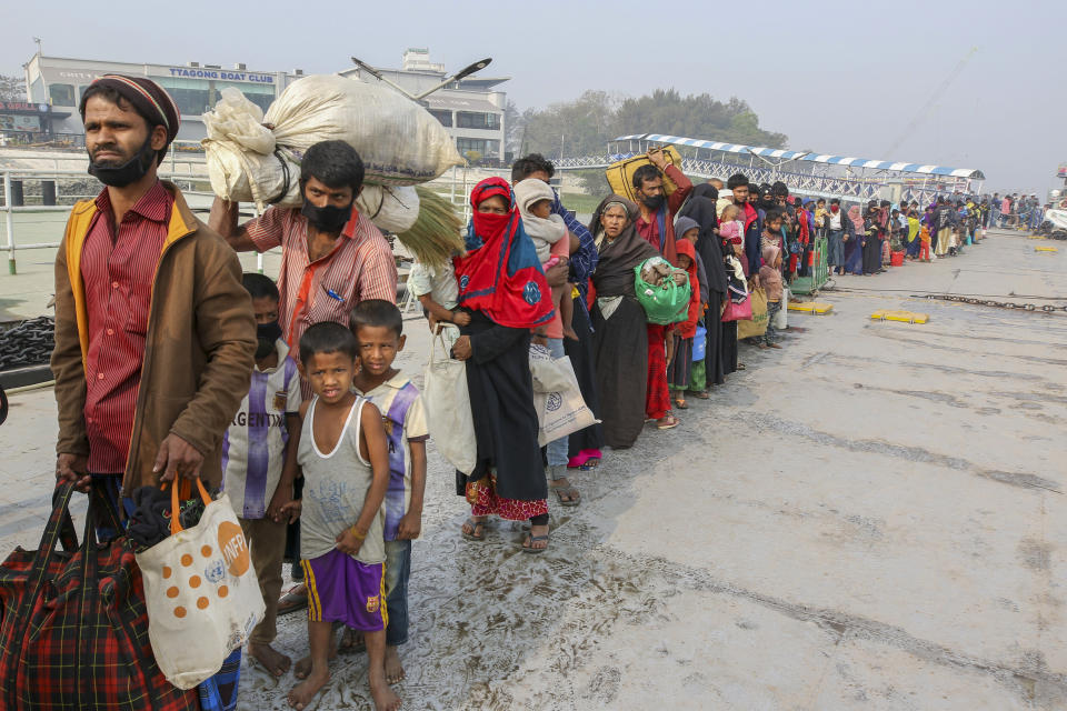 Rohingya refugees headed to the Bhasan Char island prepare to board navy vessels from the south eastern port city of Chattogram, Bangladesh, Monday, Feb.15,2021. Authorities sent a fourth group of Rohingya refugees to the newly developed island in the Bay of Bengal on Monday amid calls by human rights groups for a halt to the process. (AP Photo)