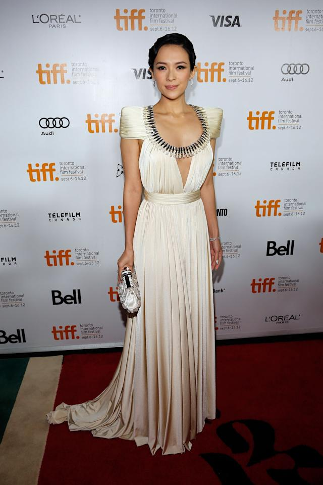"""BEST: Ziyi Zhang showed Toronto what """"elegance"""" truly means in this brilliant ivory gown. The capped sleeves! The detailed neckline! The gorgeous hair! It all screams """"Old Hollywold Glamour,"""" and we love it."""