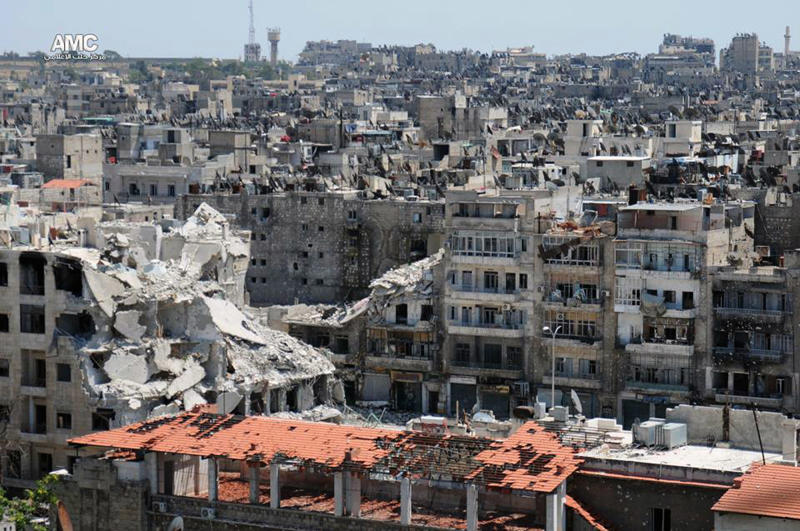 This Wednesday, June 5, 2013 citizen journalism image provided by Aleppo Media Center AMC which has been authenticated based on its contents and other AP reporting, show damaged buildings during battles between the rebels and the Syrian government forces, in Aleppo, Syria. An Austrian defense ministry official says Syrian rebels have captured a crossing point along a ceasefire line patrolled by U.N. troops between Syria and Israel. (AP Photo/Aleppo Media Center AMC)
