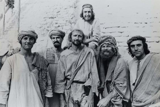Jones (far right) with his Python colleagues on the set of 'Life of Brian' (PA)