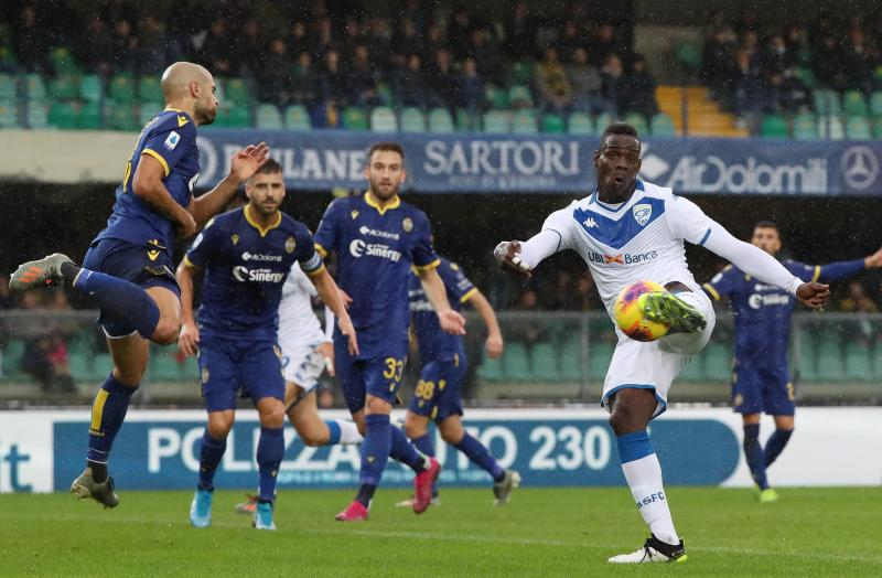 Brescia's Mario Balotelli, right, kicks the ball during the Italian Serie A soccer match between Verona and Brescia at the Bentegodi stadium in Verona, Italy, Sunday, Nov. 3, 2019. (Simone Venezia/ANSA via AP)