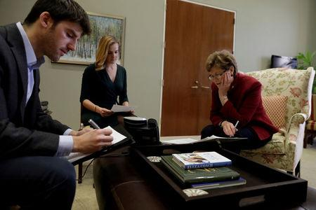 FILE PHOTO: US Senator Jean Shaheen (D-NH) prepares for a conference call at her office on Capitol Hill in Washington