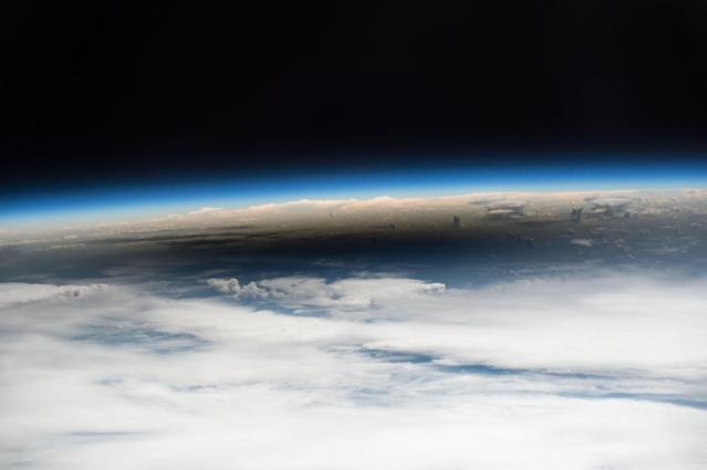 <p>As millions of people across the United States experienced a total eclipse as the umbra, or moon's shadow passed over them, only six people witnessed the umbra from space on Aug. 21, 2017. Viewing the eclipse from orbit were NASA's Randy Bresnik, Jack Fischer and Peggy Whitson, ESA (European Space Agency's) Paolo Nespoli, and Roscosmos' Commander Fyodor Yurchikhin and Sergey Ryazanskiy. The space station crossed the path of the eclipse three times as it orbited above the continental United States at an altitude of 250 miles. (Photo: NASA) </p>