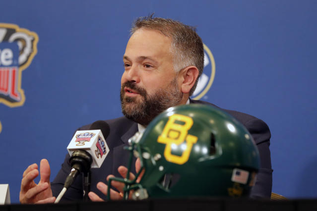 FILE - In this Dec. 31, 2019, file photo, Baylor head coach Matt Rhule talks to reporters during a Sugar Bowl NCAA college news conference in New Orleans. A person familiar with the situation says the Carolina Panthers are completing a contract to hire Baylor's Matt Rhule as their coach. The person spoke to The Associated Press on Tuesday, Jan. 7, 2020, on condition of anonymity because the deal is not done. The Panthers have not spoken publicly about the coaching search. (AP Photo/Gerald Herbert, File)
