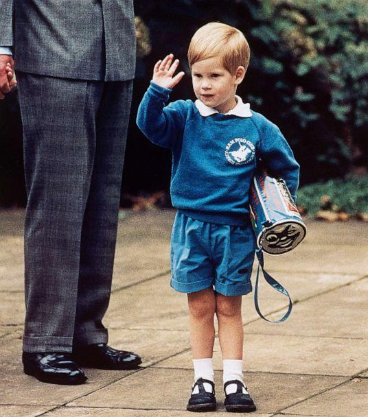 PHOTO: Britain's Prince Harry waves to photographers while holding a Thomas The Tank Engine bag on his first day at a kindergarten in Notting Hill, West London, Sept. 16, 1987. (Martin Cleaver/AP, FILE)