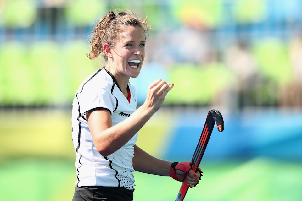 RIO DE JANEIRO, BRAZIL - AUGUST 17:  Janne Muller-Wieland of Germany celebrates scoring a goal during the penalty shootout in the womens semifinal match between the Netherlands and Germany on Day 12 of the Rio 2016 Olympic Games at the Olympic Hockey Centre on August 17, 2016 in Rio de Janeiro, Brazil.  (Photo by Mark Kolbe/Getty Images)
