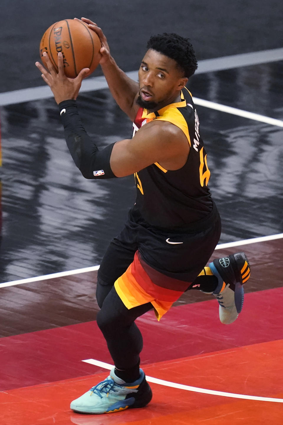 Utah Jazz guard Donovan Mitchell brings the ball up during the first half of the team's NBA basketball game against the Oklahoma City Thunder on Tuesday, April 13, 2021, in Salt Lake City. (AP Photo/Rick Bowmer)