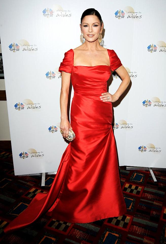 """Welsh beauty Catherine Zeta-Jones turned heads when she walked the red carpet at the """"Welcome to Wales"""" event in Cardiff thanks to the ruby-red Reem Acra dress and Lorraine Schwartz chandelier earrings she donned. Eamonn McCormack/<a href=""""http://www.gettyimages.com/"""" target=""""new"""">GettyImages.com</a> - September 29, 2010"""