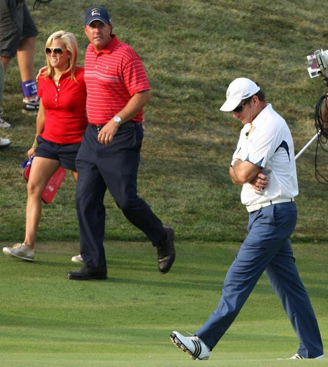 A dejected Nick Faldo accepts defeat, with Phil Mickelson looking on