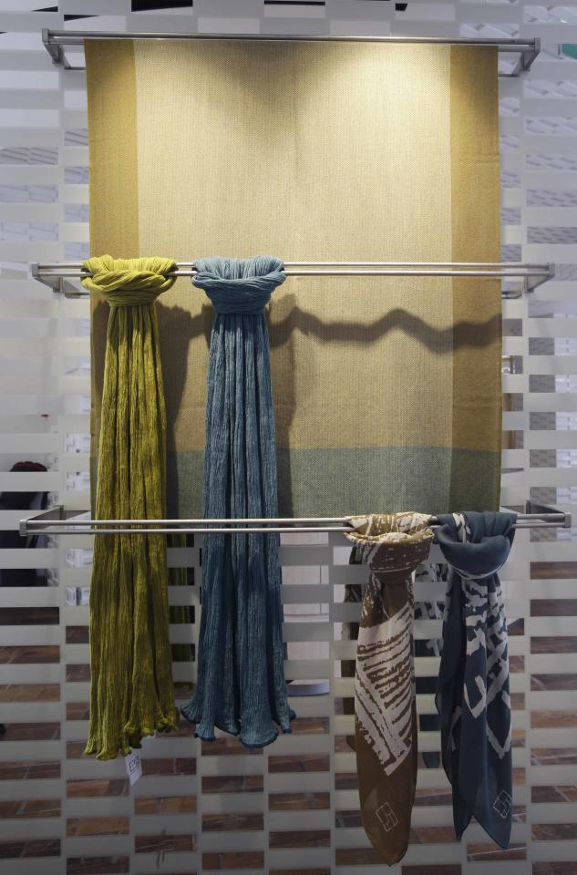 Scarves are displayed for sale in the shop of the young brand Shang Xia on its opening day in Paris September 11, 2013. Shang Xia, the Chinese-born brand backed by French luxury goods group Hermes, opened its first shop outside its home market in Paris on Wednesday to test appetite among non-Chinese customers for its handcrafted products. The brand is trying to build a business centred on the revival of traditional Chinese crafts such as porcelain, cashmere felt and furniture, that were all but nearly destroyed by China's proletarian Cultural Revolution. REUTERS/Jacky Naegelen (FRANCE - Tags: FASHION BUSINESS)