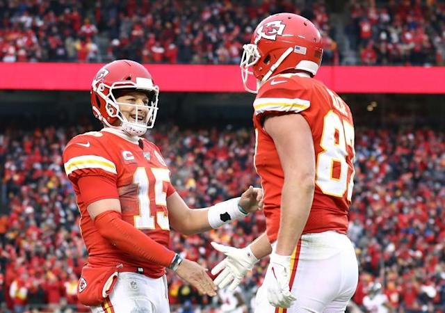 Quarterback Patrick Mahomes (left) celebrates a touchdown by teammate Travis Kelce in Kansas City's defeat of the Houston Texans (AFP Photo/JAMIE SQUIRE)
