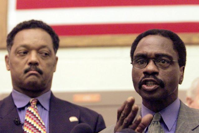 """FILE - In this March 3, 2000 file photo, the Rev. Jesse Jackson, left, listens as Rubin """"Hurricane"""" Carter, the former middleweight boxer, speaks during a news conference inside the North County Correctional Facility in Castaic, Calif. Carter, who spent almost 20 years in jail after twice being convicted of a triple murder he denied committing, died at his home in Toronto, Sunday, April 20, 2014, according to long-time friend and co-accused John Artis. He was 76. (AP Photo/Damian Dovarganes, File)"""