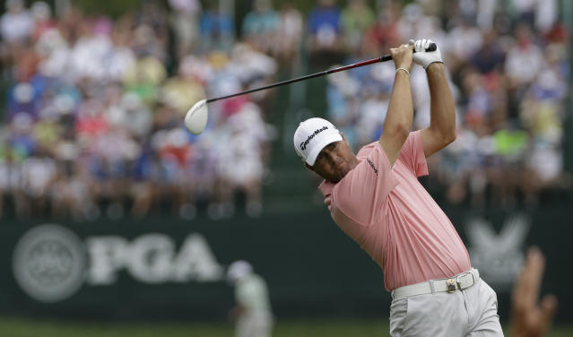 Ryan Palmer watches his tee shot on the fifth hole during the first round of the PGA Championship golf tournament at Valhalla Golf Club on Thursday, Aug. 7, 2014, in Louisville, Ky. (AP Photo/David J. Phillip)