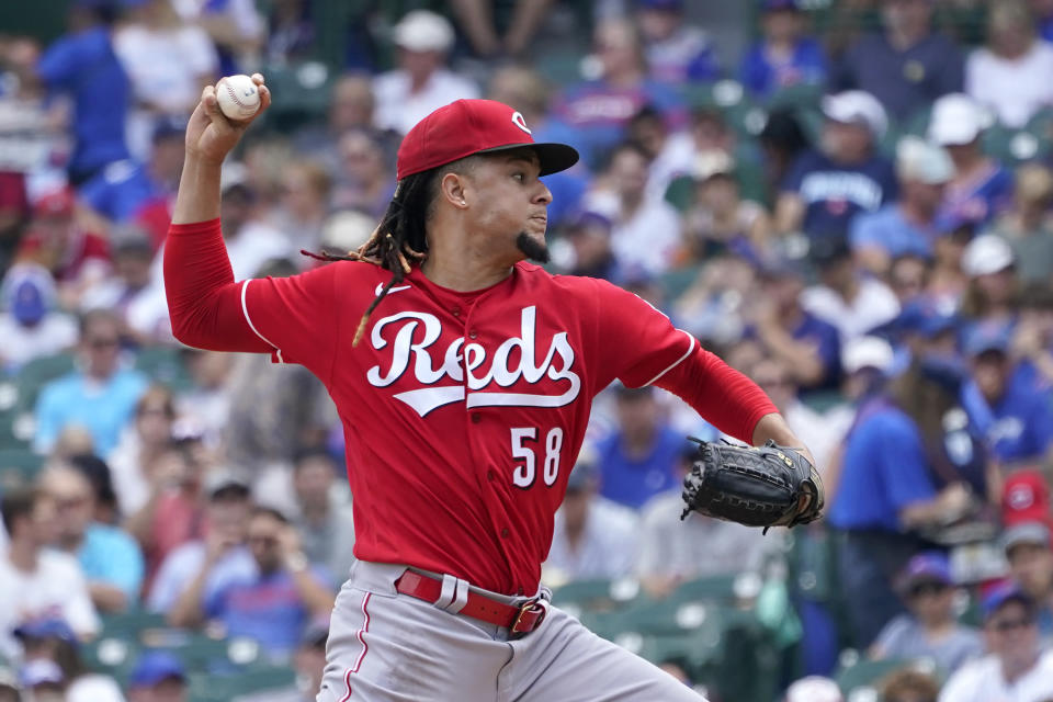 Cincinnati Reds starting pitcher Luis Castillo delivers during the first inning of a baseball game against the Chicago Cubs Thursday, July 29, 2021, in Chicago. (AP Photo/Charles Rex Arbogast)