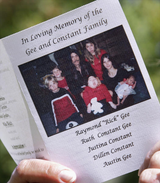 FILE - In this Sept. 28, 2009 file photo, a memorial pamphlet is seen as friends and family of the Gee family exit the Family Life Center in Mount Pulaski, Ill., for their funeral, a week after the two parents and three children were found dead in their Beason, Ill., home. Top center is Raymond Gee; top right is Justina Constant; top left is Austin Gee; bottom left is Dillen Constant; bottom center child is unidentified; bottom right is Ruth Constant Gee with daughter Tabitha. On Thursday, May 30, 2013, closing arguments began in Peoria, Ill., in the trial of Christopher Harris who is accused of killing the five members of his ex-wife's family. (AP Photo/Seth Perlman, File)