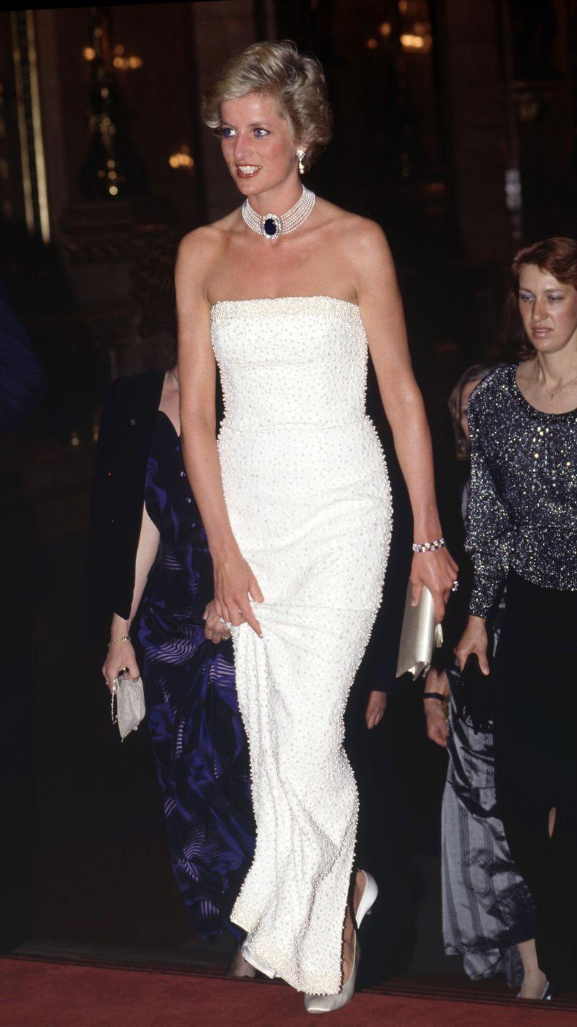 <p>In a white strapless dress with a glittering choker in Budapest, Hungary. </p>