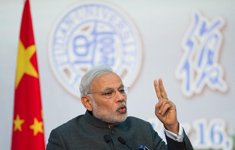 Indian Prime Minister Narendra Modi delivers an address at the Centre for Gandhian and Indian Studies in Shanghai on May 16, 2015 (AFP Photo/Johannes Eisele)