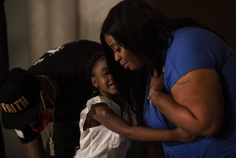 Roxie Washington embraces her daughter Gianna Floyd at a press conference to call for justice for George Floyd: Getty Images