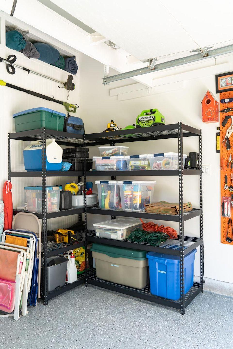 """<p>Stock up on a couple of sturdy metal shelves, line your garage walls with them, and get your bigger items, like power tools, out of the way in no time. Add bins for storing smaller bits that might otherwise end up scattered on the floor.</p><p><strong>Get the tutorial at <a href=""""https://abbymurphyphoto.com/garage-makeover/"""" rel=""""nofollow noopener"""" target=""""_blank"""" data-ylk=""""slk:Abby Murphy"""" class=""""link rapid-noclick-resp"""">Abby Murphy</a>.</strong></p><p><a class=""""link rapid-noclick-resp"""" href=""""https://www.amazon.com/AmazonBasics-4-Shelf-Shelving-Unit-Black/dp/B01LYBQXRH/ref=sr_1_5?tag=syn-yahoo-20&ascsubtag=%5Bartid%7C10050.g.36449426%5Bsrc%7Cyahoo-us"""" rel=""""nofollow noopener"""" target=""""_blank"""" data-ylk=""""slk:SHOP METAL SHELVES"""">SHOP METAL SHELVES</a><br></p>"""