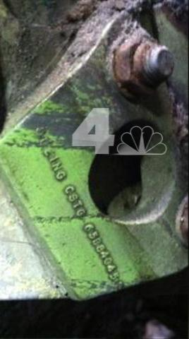 In this April 26, 2013 photo provided by WNBC-TV in New York, a section of wreckage from a landing gear bearing a Boeing serial number is shown. The landing gear was found wedged in between two New York City buildings not far from the World Trade Center construction site. It's believed to be from one of the airliners that were crashed into the World Trade Center in the terrorist attacks of September 11, 2001. (AP Photo/WNBC-TV) MANDATORY CREDIT NO SALES