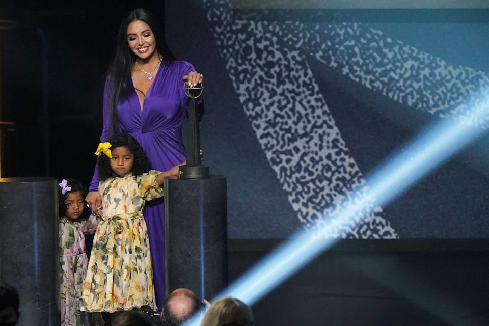 Vanessa Bryant on stage with daughters Capri and Bianka after speaking during Kobe Bryant's enshrinement.